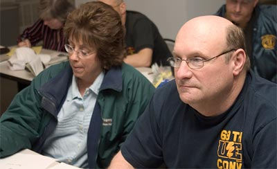 GE Conference Board photo of Marcia Barnhart and John Payne, Local 731
