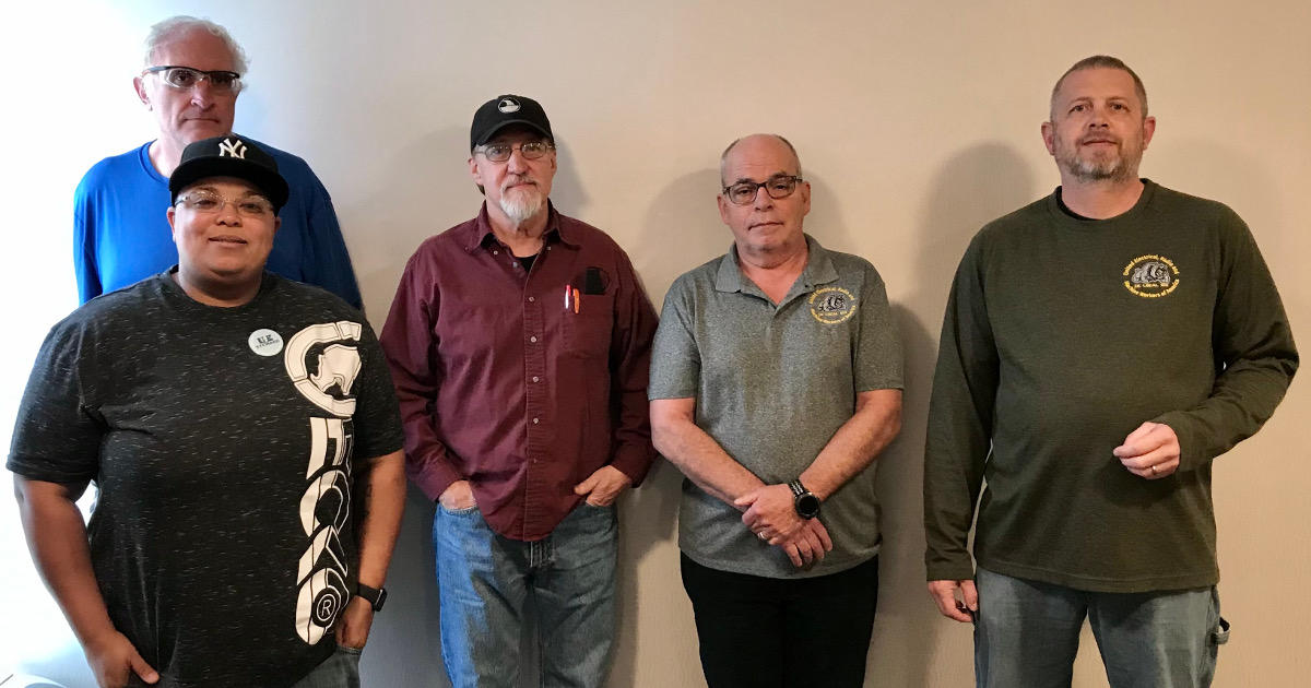 The five members of the UE Local 123 negotiating committee