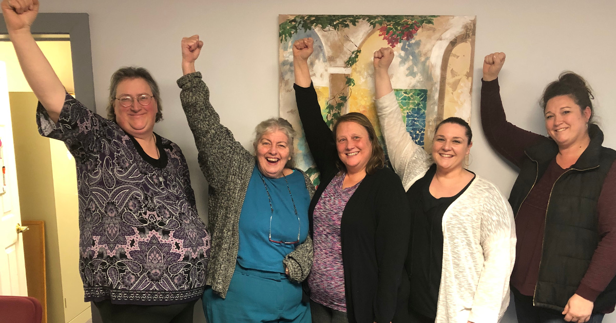 Five women with raised fists