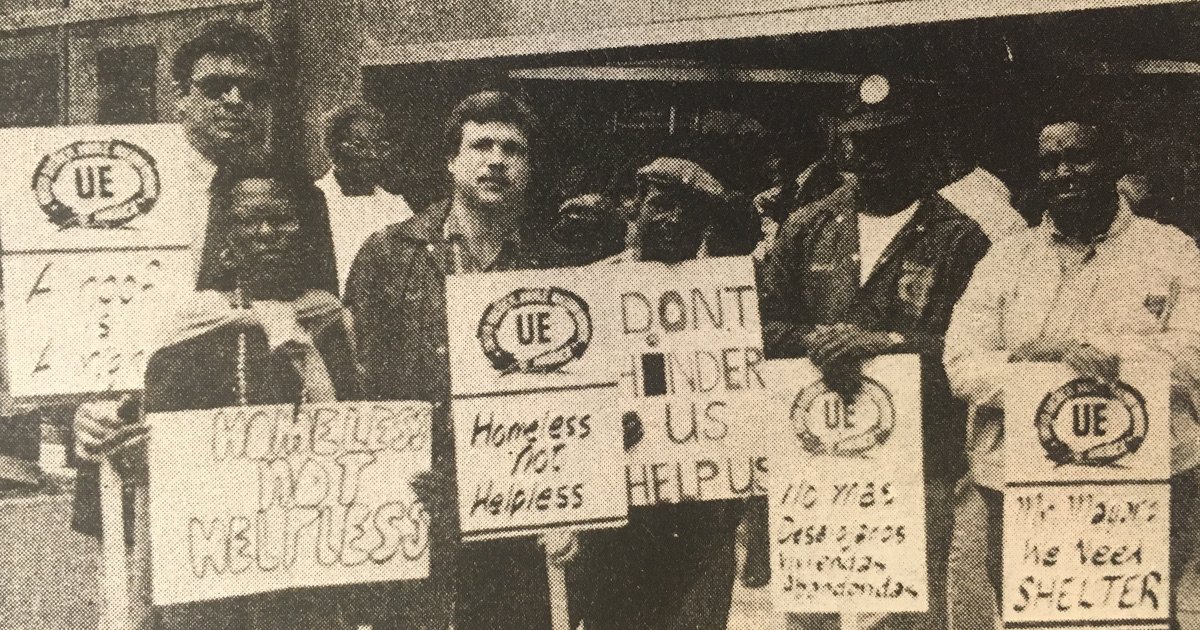 """An old UE NEWS photo of a group of UE members holding signs saying """"Homeless not helpless"""""""