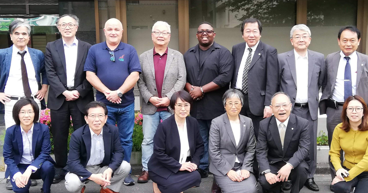 Local 150 President Bryce Carter posing with other public-sector trade unionists for a group photo in Japan