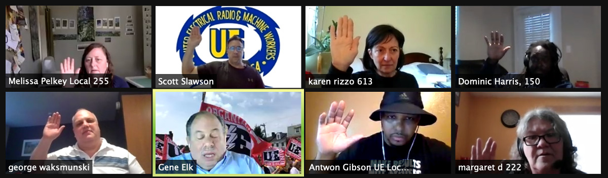Eight UE members on a Zoom conference with their hands raised, taking an oath