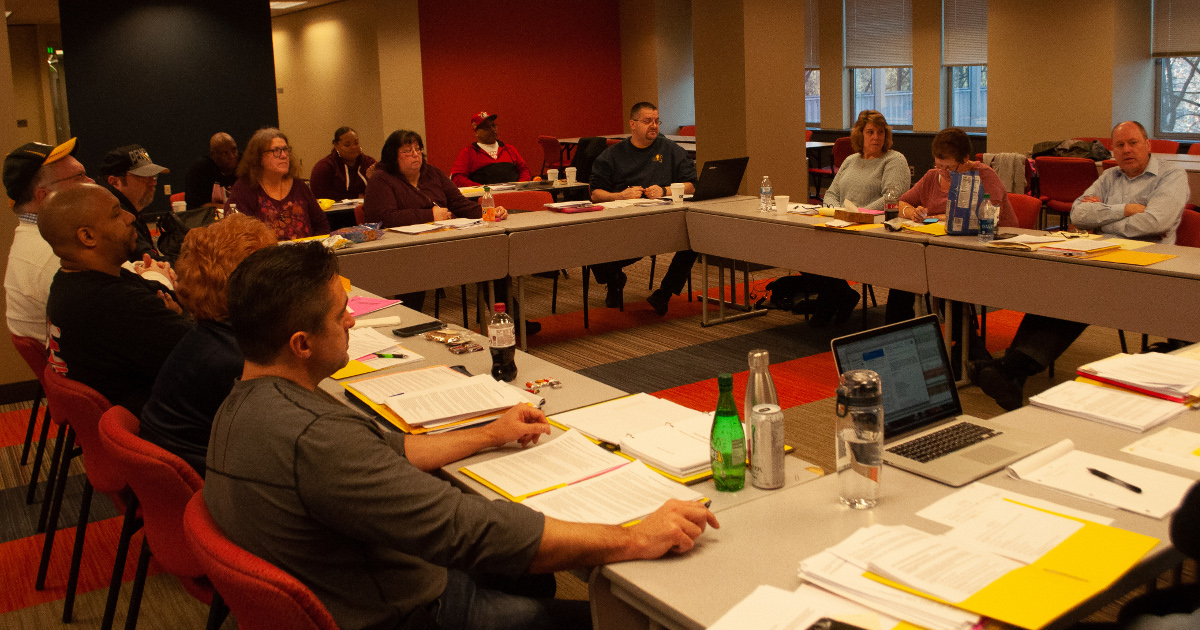 General Executive Board members meeting in a conference room