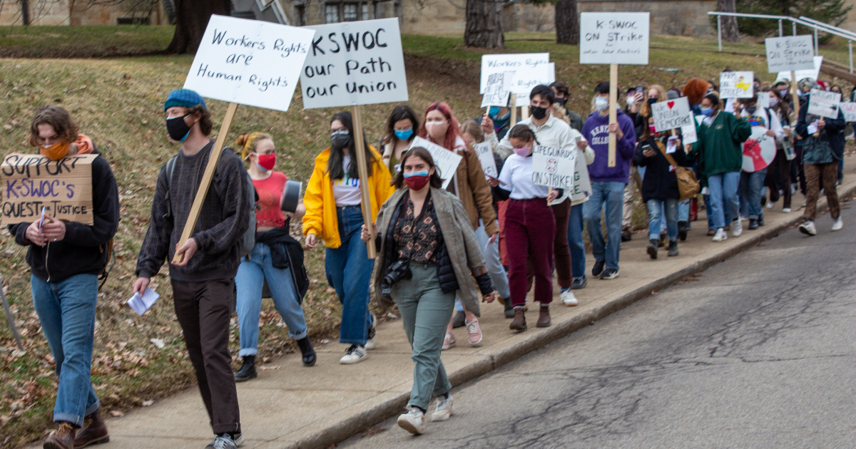 Striking Kenyon College student workers, members of K-SWOC, marching with signs