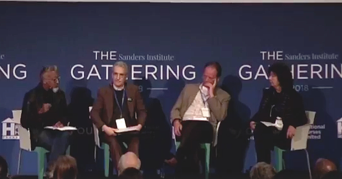 "Panel consisting of Joseph Geevarghese, Mark Dimondstein, Peter Knowlton and RoseAnn DeMoro in front of a screen that reads ""The Sanders Institute Gathering"""