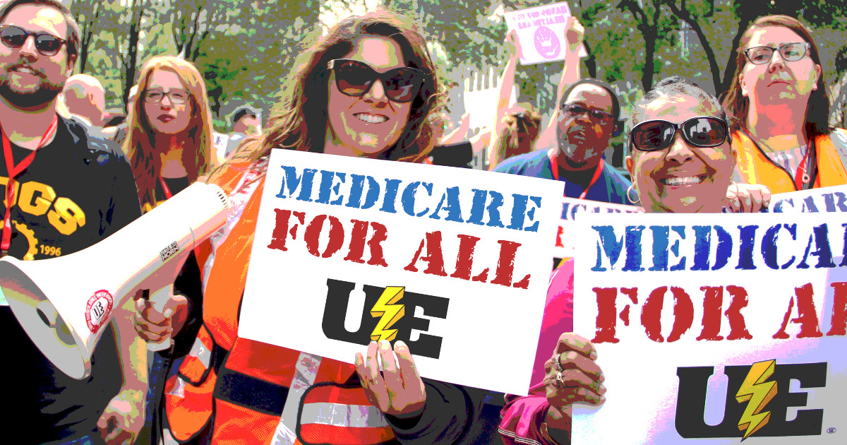 UE members marching with Medicare for All signs
