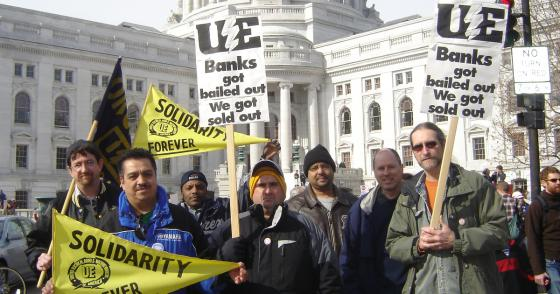UE members at Wisconsin state capitol with signs reading Solidarity Forever and Banks Got Bailed Out We Got Sold Out