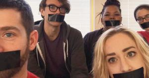 UE members with duct tape over their mouths